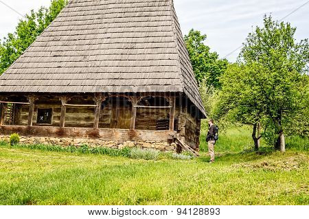 Bearded Man Looking At An Old House