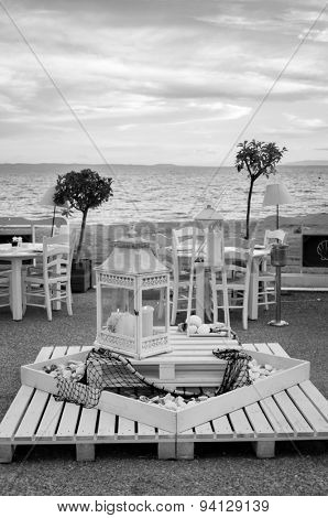 Beach bar with sea and sky in the background - black and white photo