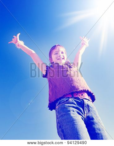 Instagram of young joyful girl with arms raised up towards perfect blue sky and sunshine