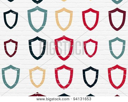 Privacy concept: Contoured Shield icons on wall background