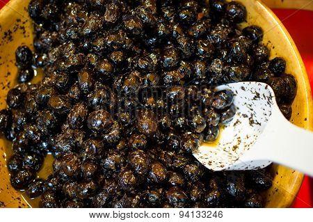 Black Olives In The Wooden Bowl Sold On Market