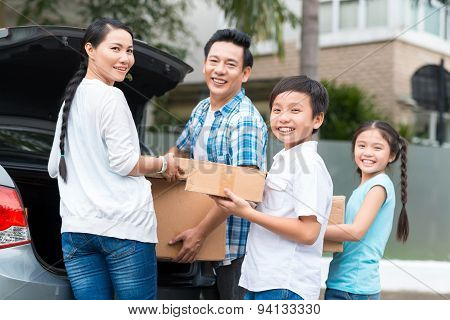 Family With Cardboard Boxes