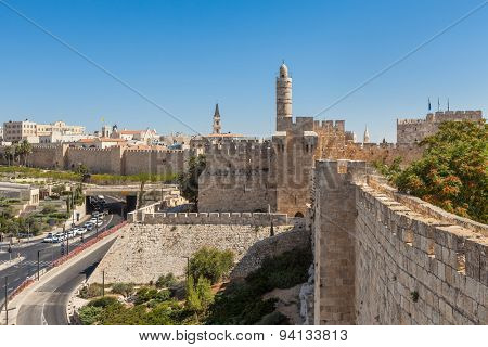 Ancient walls and old Tower of David under blue sky in Jerusalem, Israel.