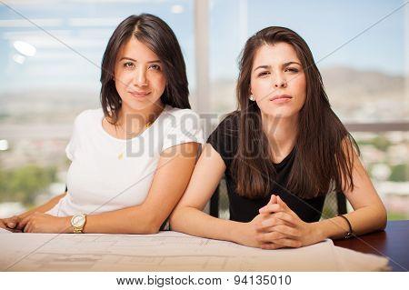 Pretty Hispanic Women In An Office