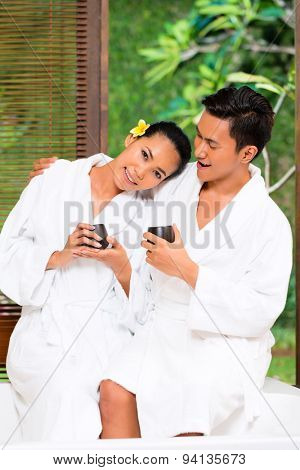Indonesian Asian couple drinking tea in wellness spa