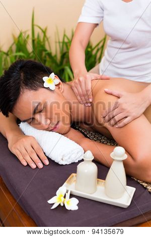 Indonesian Asian man in wellness beauty spa having aroma therapy massage with essential oil, looking relaxed