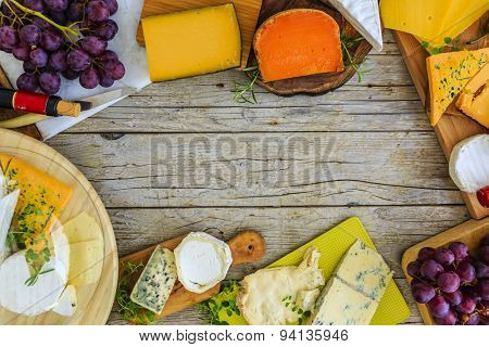 Cheese - different types of cheese on a wooden background