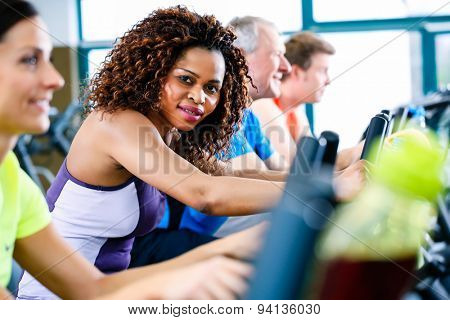 Diversity group of young and senior, Caucasian and black people on treadmill in gym