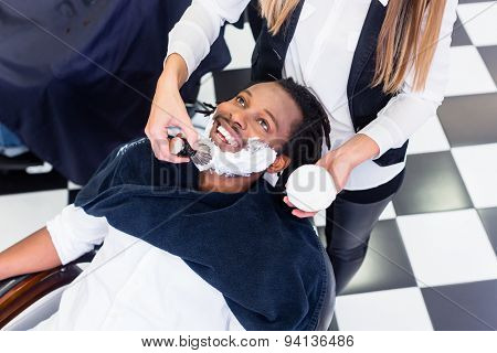 Customer at barber shop with shaving cream