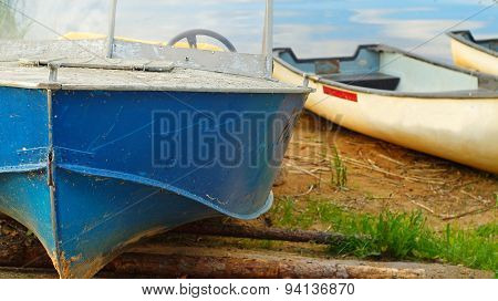 Old motor boat on the lake coast