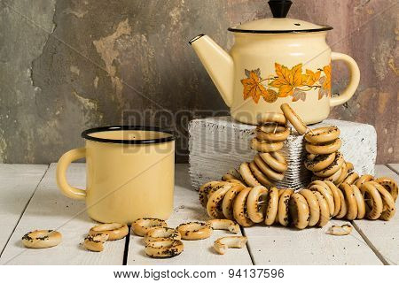 Old Tea Enamelware And Dry Bagels With Poppy