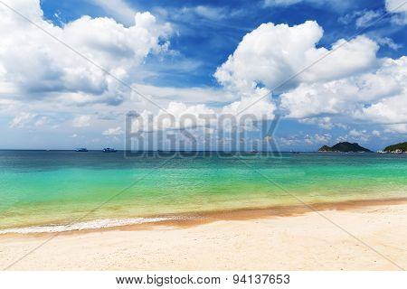 Tropical White Sand Beach Arainst Blue Sky