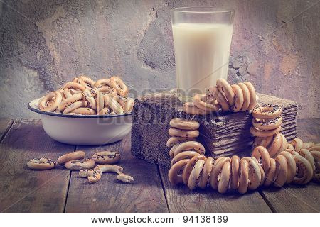 Retro Composition: Glass Of Milk And A Lot Of Small Dry Bagels