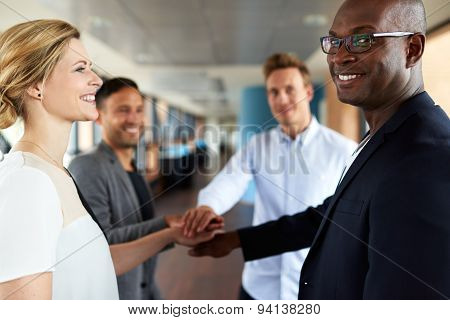 Group Of Young Executives Smiling Before Teamwork