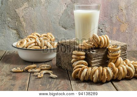 A Glass Of Milk And Dry Small Bagels In A Bowl - Vintage Style