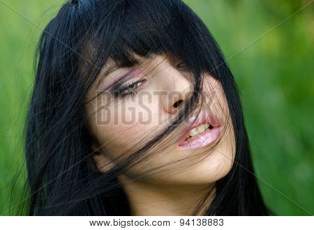 Portrait Of The Beautiful Girl In Spring Nature