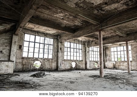 Empty Industrial Loft In An Architectural Background With Bare Cement Walls, Floors And Pillars Supp