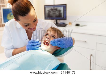 cute boy visits the dentist for a check up