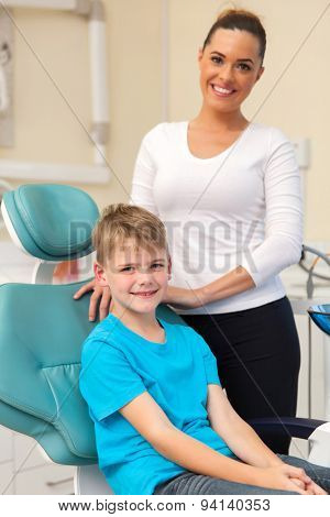 portrait of beautiful mother and her son in dentist's office