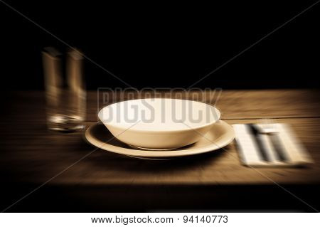 Empty Plate On Wooden Table - blurred style photo