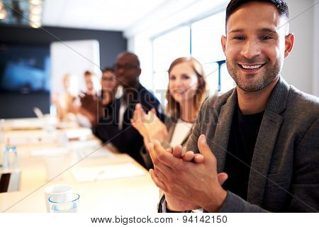 Group Of Executives Facing Camera And Clapping