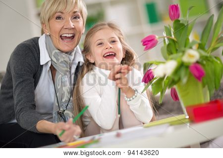 Happy grandma  and little girl looking at surprise