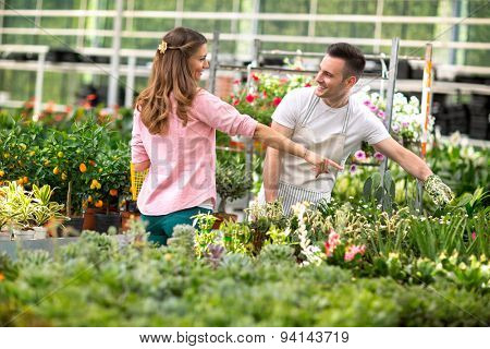 Employer surrounded by plant in greenhouse