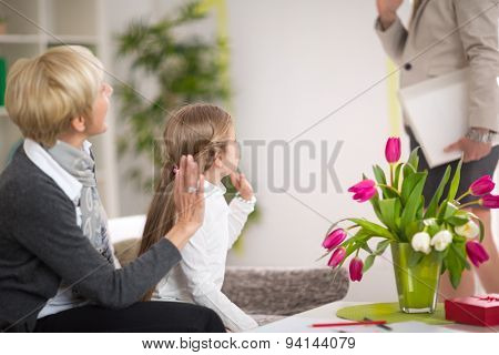 Girl greeting her mother and stay at home with her grandmother, gesture, happiness, generation, home and people concept