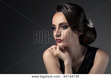 Beautiful Woman. Fashion Festive Coiffure with Pearls. Upsweep. Hairstyle.