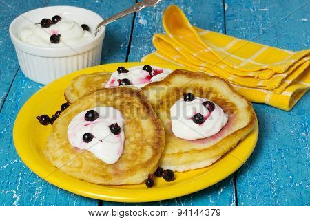 Fritters With Cream And Berry Sauce For Breakfast