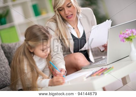 daughter doing homework with mom's help, concept education at home