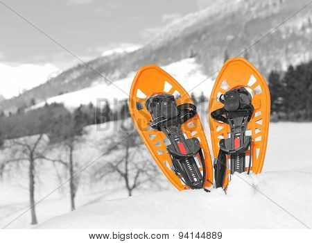 Orange Snowshoes In Mountains In Winter
