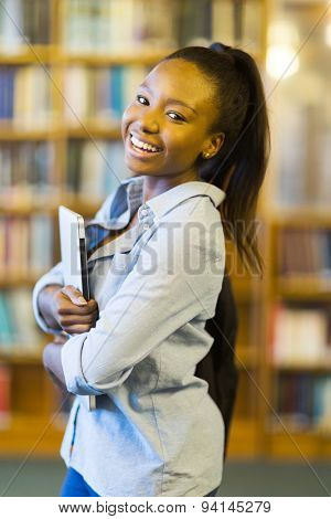 cheerful african american college student with laptop computer
