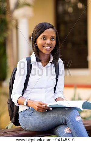 pretty young african college student outdoors