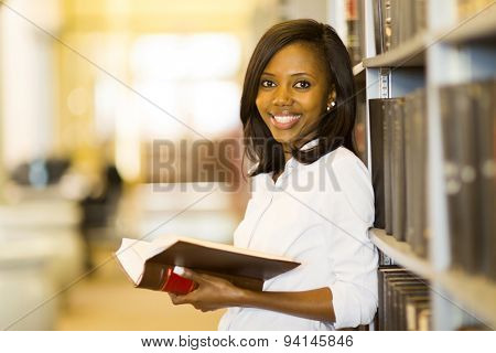 smiling female african american student in university library