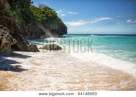 Tropical beach with clear emerald water and white sands