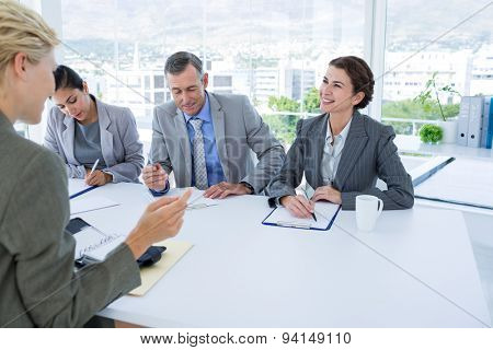 Interview panel listening to applicant in the office