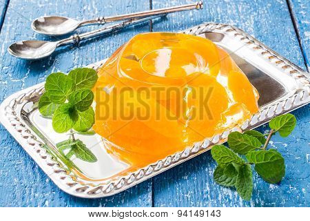 Delicious Cold Jelly With Slices Of Orange And Fresh Mint