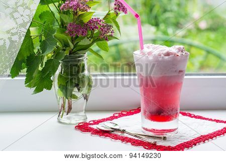 A Freshly Prepared Fruit Cocktail With Ice Cream On The Window