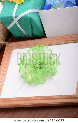 Valentine Frame With Flowers, Gift Boxes And Empty Wooden Frame