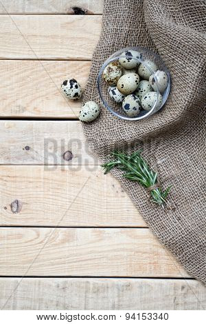 Quail Eggs, A Bunch Of Rosemary And Burlap Are On The Unpainted Wooden Background