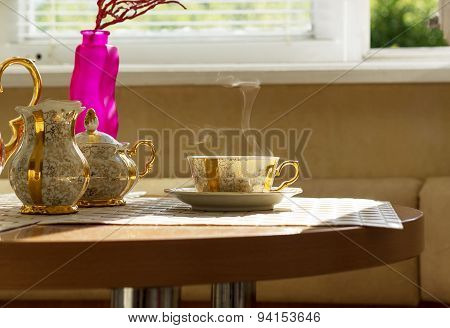 Gilt cup of coffee on table in cafe
