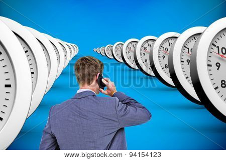 Back turned businessman on the phone against blue background with vignette