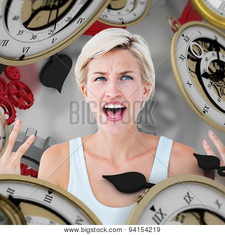 Angry blonde yelling with hands up against grey vignette