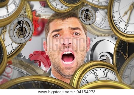 Businessman screaming against grey background with vignette