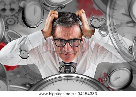 Stressed businessman touching his head against grey vignette