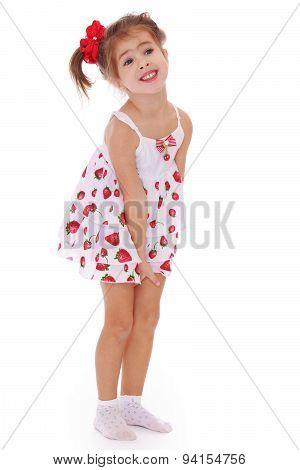 Gentle little girl in a short dress