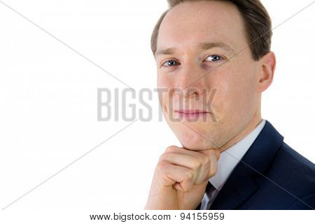 Thoughtful businessman looking at camera on white background