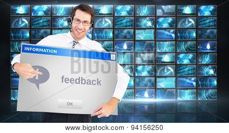 Happy businessman showing card to camera against info box