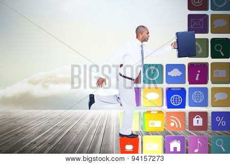 Businessman running with briefcase against wooden planks leading to bright sky
